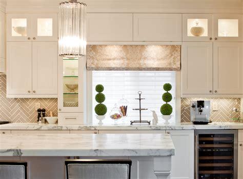 black glass backsplash herringbone tile backsplash kitchen transitional with bar