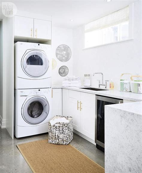 White Laundry Room Cabinets With Brushed Brass Octagon