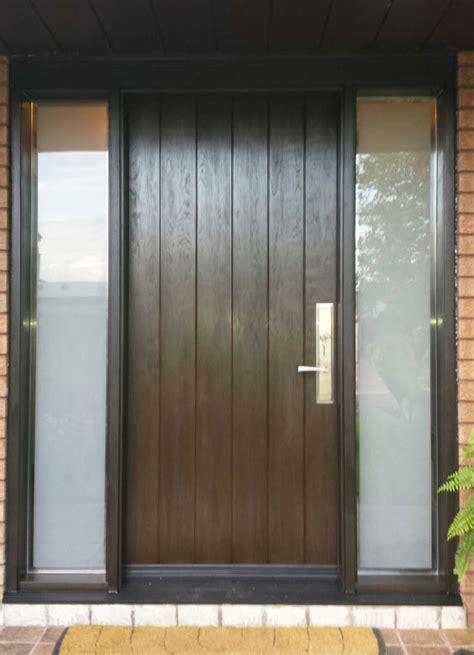 single fiberglass rustic door   frosted side lites