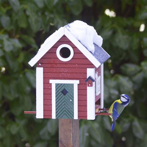 red cottage bird feeder nesting box  blue door
