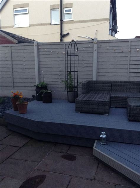 muted clay fence panels  silver birch decking paint