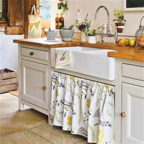 Money Saving Storage: Sink Skirt   28 Thrifty Ways to