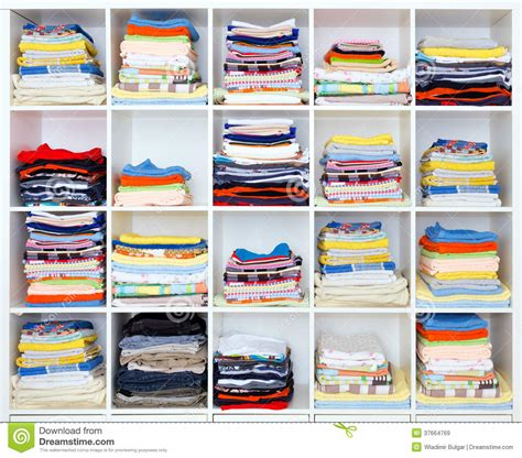 on a shelf clothes towels bed sheets and clothes on shelf stock image