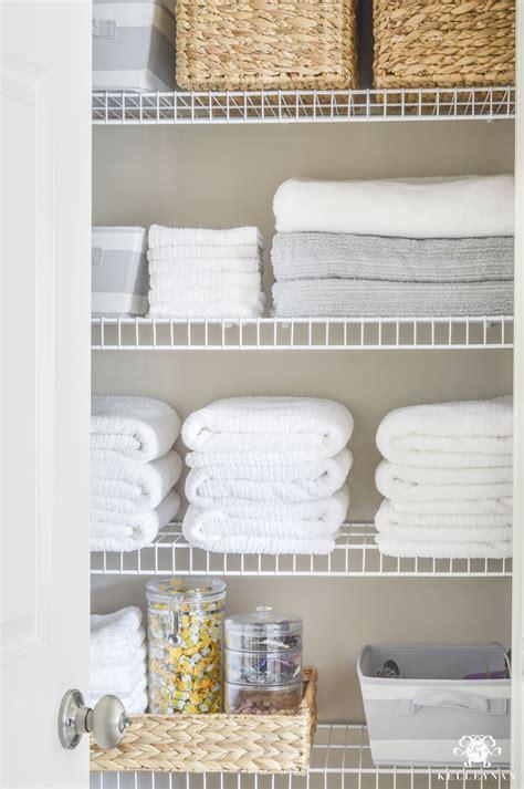 Linen Closet Baskets by Organized Bathroom Linen Closet Anyone Can Kelley Nan