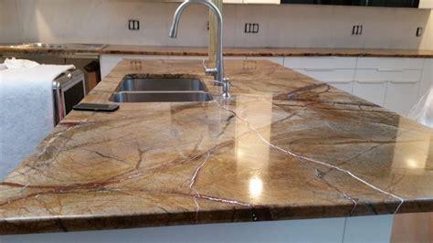rainforest brown granite countertop installation in