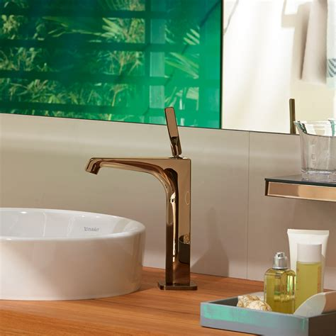 coloured surface finishes for mixers and showers