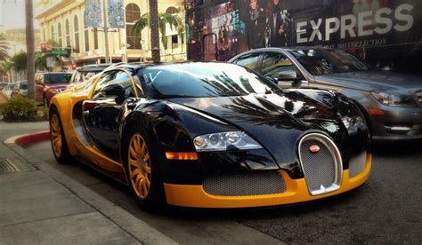 yellow bugatti yellow and black bugatti veyron on rodeo drive in beverly