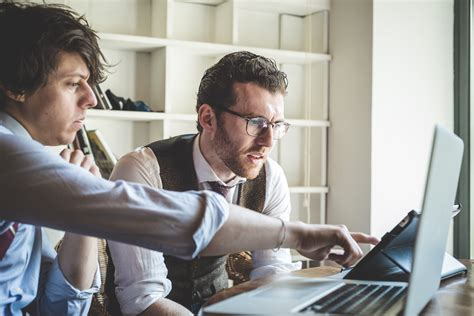 Two Young Hipster Stylish Elegant Men Working With