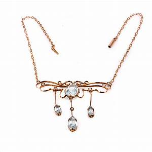 Antique aquamarine and pearl necklace set in rose gold.