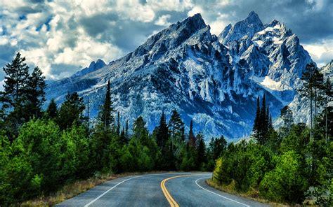 snowy mountain landscape road grand teton national park