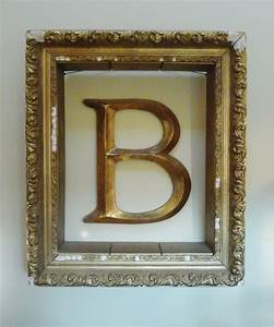 Hang letter monogram on wall inside empty picture frame for Frame with letter inside