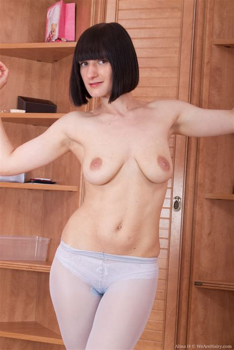 Alina H Is All Dressed In Purple Stripping Naked