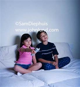 Kids Watching Television in Thier Bedroom