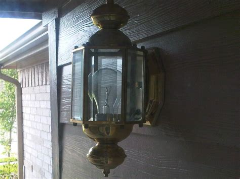 changing the light bulb in an outdoor fixture howe move