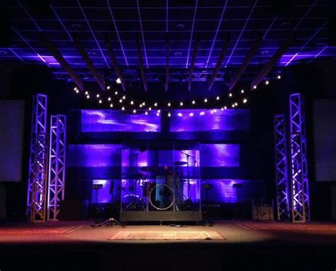 edgy stage design includes sheets  hanging metal