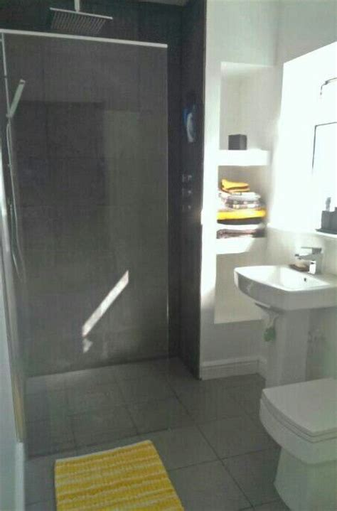 small grey  yellow wet room finished bathroom