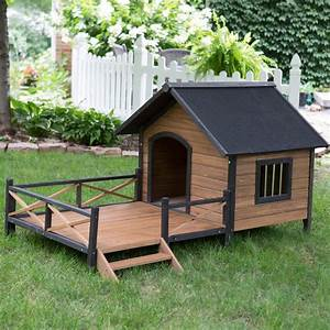 large solid wood outdoor dog house with spacious deck With large outdoor dog house