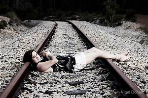 Girl tied to train tracks