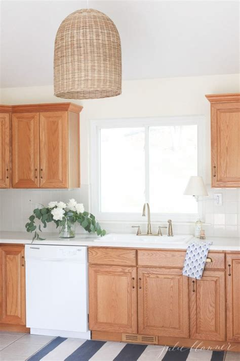 how to update oak kitchen cabinets updating a kitchen with oak cabinets without painting them 8942