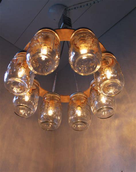 wagon wheel light with mason jars wagon wheel mason jar chandelier mason from boots n gus