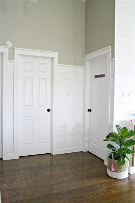 Shiplap Door by Finished Shiplap Walls And Farmhouse Door Trim In The Loft