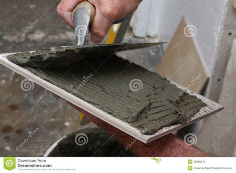 thin set mortar spread on tile royalty free stock photo