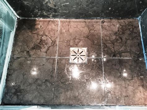 limestone kitchen floor and shower tiles refinished in