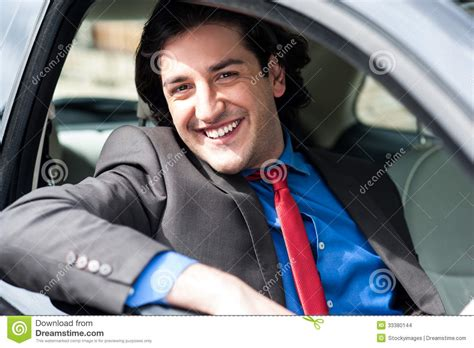 Portrait Of Handsome Guy Driving His Car Stock Images