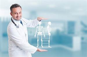 Handsome Orthopedist Doctor Holding Skeleton Model Hologram On H Stock Image