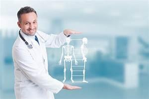 Handsome Orthopedist Doctor Holding Skeleton Model Hologram On H Stock Image