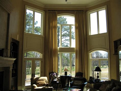 home with high windows and elaborate drapes size