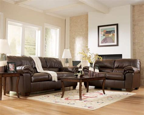 living room with brown furniture including leather sofas