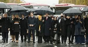 Erdoğan joins rainy Champs-Elysees walk, Trump arrives in ...