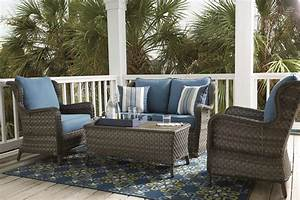 enliven outdoor spaces with rugs and pillows ashley With homestore and more outdoor furniture