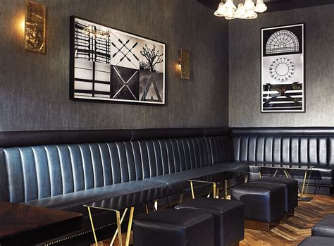 Custom Dark Blue Leather Banquettes. Steel And Brass