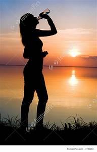 Woman Drinking Water At Sunset Stock Image I1743054 At