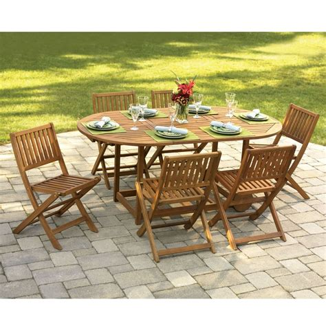 Garden Patio Table And Chairs by The Gateleg Patio Table And Stowable Chairs Hammacher