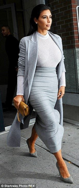 Kim Kardashian impresses in clingy top with Kanye West | Daily Mail Online