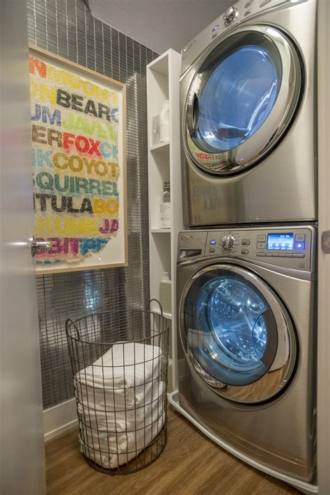 washer laundry dryer room hgtv stackable stainless steel closet space smart stacked load rooms front apartment stairs fantasy garage door