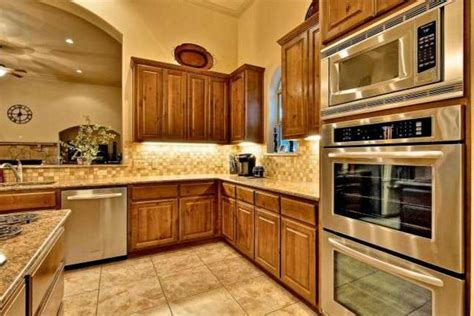 kitchen arch stainless steel appliances oak cabinets