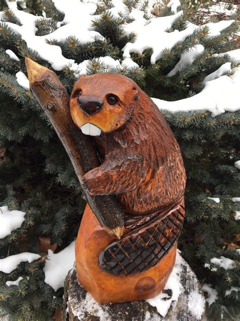 chainsaw carving beaver  stick wood carved beaver