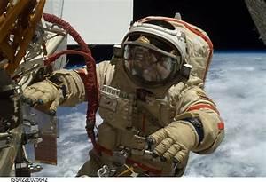 Russian cosmonaut wearing an Omega Speedmaster ...
