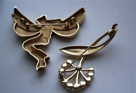 2 Brooches From Costume Jewelry Maker Pl  Collectors Weekly