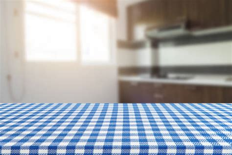 table high resolution kitchen background empty table with tablecloth and blurred kitchen background