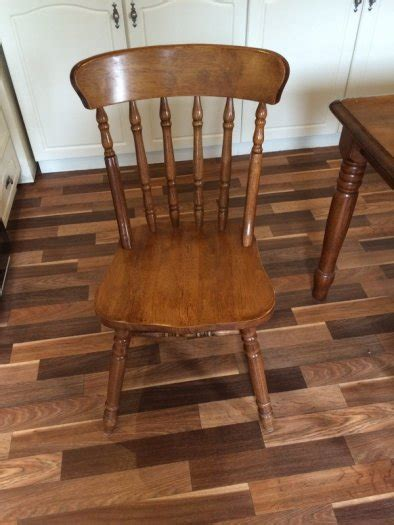 great condition rubber wood dining table and six chairs