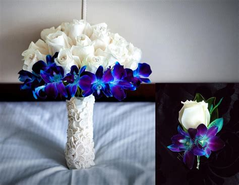 ivory rose  blue orchid reception wedding flowers