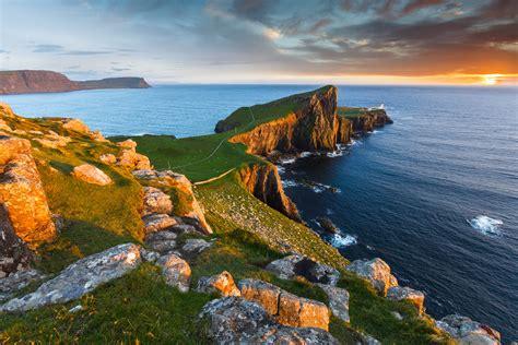 Neist Point Lighthouse In The Isle Of Skye Sunset On