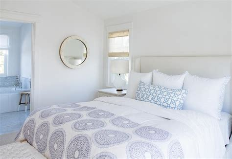 White Wingback Bed With Blue Bedding