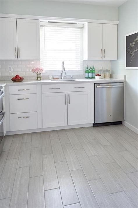 Kitchen Floor Tiles For White Cabinets by Style Selections Leonia Silver Porcelain Floor Tile