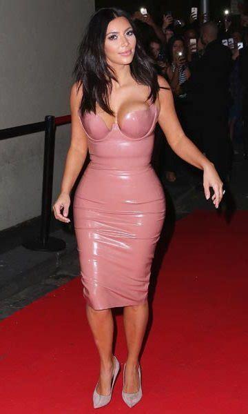 kim kardashian flaunts  curves   pink latex dress